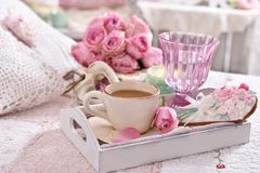 Romantic coffee served to bed with bunch of roses Stock Photography