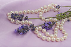 Romantic composition of the branches of blooming lavender. And necklaces Royalty Free Stock Images