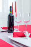 Romantic composition of candles, wine and glasses Stock Images