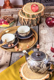 Romantic composition of cups and cookies on wooden table Stock Images
