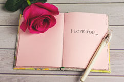 Romantic composition with rose flowers and text I love you St. Valentines Day background. Copy space Stock Photography