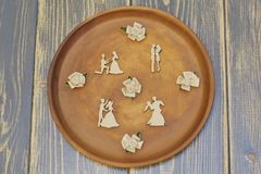 Romantic composition of vintage figures of dancing lovers and satin decorative flowers in pastel colors on clay dish for day of royalty free stock photos