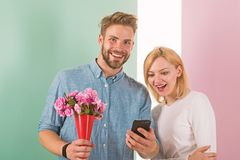 Romantic concept. Couple in love interested by phone. Man shows photo on smartphone to girl, sweet memories of their royalty free stock image
