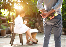 Romantic concept with man holding white rose and ring making marriage stock photo