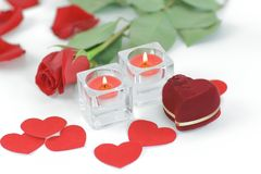 Romantic concept . ring, candles and rose on white background.  stock photo