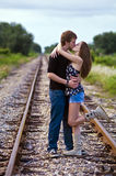 Romantic Couple. A romantic couple kissing on the rail tracks Royalty Free Stock Image