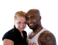 Romantic Couple. An interracial couple smile at the camera stock photos