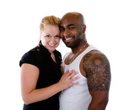 Romantic Couple. An interracial couple smiles at the Camera stock photography