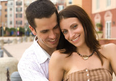 Romantic couple. A man and a woman sitting, woman looking into camera Stock Images