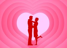 Romantic Couple. Silhouette in front of concentric hearts Royalty Free Stock Photo