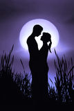 Romantic Couple. Silhouettes of a man and a woman in love Stock Photos