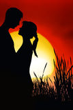 Romantic Couple. Silhouettes of a man and a woman in love Stock Image
