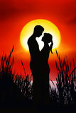 Romantic Couple. Silhouettes of a man and a woman in love Royalty Free Stock Photo