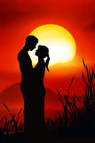 Romantic Couple. Silhouettes of a man and a woman in love Stock Photo