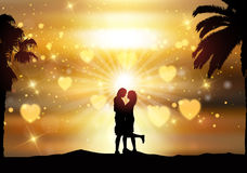Romantic couple against a sunset sky Stock Image