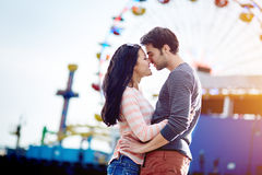 Romantic couple at amusement park Royalty Free Stock Image