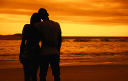 Romantic couple in arms on beach at sunset. Romantic couple in arms outdoor on beach at sunset stock photos