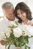 Romantic Couple Arranging Flowers Royalty Free Stock Image