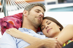 Romantic Couple Asleep In Garden Hammock Together Stock Photos