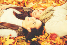 Romantic couple in the autumn park. Holidays, love, relationship and dating concept - romantic couple in the autumn park Royalty Free Stock Photo
