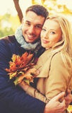 Romantic couple in the autumn park. Holidays, love, relationship and dating concept - romantic couple in the autumn park Stock Images