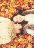 Romantic couple in the autumn park. Holidays, love, relationship and dating concept - romantic couple in the autumn park Royalty Free Stock Image