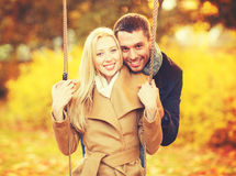 Romantic couple in the autumn park. Holidays, love, relationship and dating concept - romantic couple in the autumn park Stock Photography