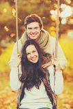 Romantic couple in the autumn park. Holidays, love, relationship and dating concept - romantic couple in the autumn park Royalty Free Stock Images
