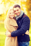 Romantic couple in the autumn park. Holidays, love, travel and dating concept - romantic couple in the autumn park Stock Images