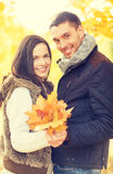 Romantic couple in the autumn park. Holidays, love, travel, relationship and dating concept - romantic couple in the autumn park Stock Photo