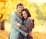 Romantic couple in the autumn park. Holidays, love, travel, relationship and dating concept - romantic couple in the autumn park Royalty Free Stock Image