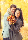 Romantic couple in the autumn park. Holidays, love, travel, relationship and dating concept - romantic couple in the autumn park Royalty Free Stock Photography