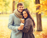 Romantic couple in the autumn park. Holidays, love, travel, relationship and dating concept - romantic couple in the autumn park Stock Image