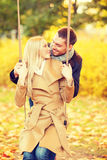 Romantic couple in the autumn park. Holidays, love, travel, relationship and dating concept - romantic couple in the autumn park Royalty Free Stock Photos