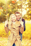 Romantic couple in the autumn park. Holidays, love, travel, relationship and dating concept - romantic couple in the autumn park Royalty Free Stock Images