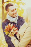 Romantic couple in the autumn park. Holidays, love, travel, relationship and dating concept - romantic couple in the autumn park Royalty Free Stock Photo