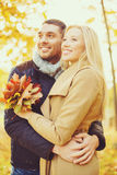 Romantic couple in the autumn park. Holidays, love, travel, relationship and dating concept - romantic couple in the autumn park Stock Images
