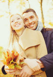 Romantic couple in the autumn park. Holidays, love, travel, relationship and dating concept - romantic couple in the autumn park Stock Photos