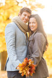 Romantic couple in the autumn park. Holidays, love, travel, tourism, relationship and dating concept - romantic couple in the autumn park Royalty Free Stock Images