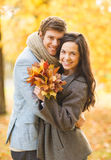 Romantic couple in the autumn park. Holidays, love, travel, tourism, relationship and dating concept - romantic couple in the autumn park Stock Image