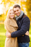 Romantic couple in the autumn park. Holidays, love, travel, tourism, relationship and dating concept - romantic couple in the autumn park Stock Photo