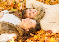 Romantic couple in the autumn park. Holidays, love, travel, tourism, relationship and dating concept - romantic couple in the autumn park Stock Photography