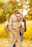Romantic couple in the autumn park. Holidays, love, travel, tourism, relationship and dating concept - romantic couple in the autumn park Royalty Free Stock Photos