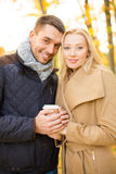 Romantic couple in the autumn park Stock Photos