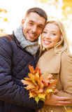 Romantic couple in the autumn park. Holidays, love, travel, tourism, relationship and dating concept - romantic couple in the autumn park Royalty Free Stock Photo