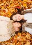 Romantic couple in the autumn park. Holidays, love, travel, tourism, relationship and dating concept - romantic couple in the autumn park Stock Images