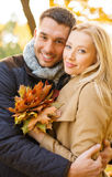 Romantic couple in the autumn park. Holidays, love, travel, tourism, relationship and dating concept - romantic couple in the autumn park Royalty Free Stock Photography