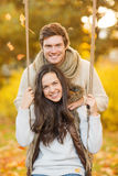 Romantic couple in the autumn park. Holidays, love, travel, tourism, relationship and dating concept - romantic couple in the autumn park Royalty Free Stock Image