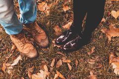 Romantic Couple in Autumn. Man and Woman. Feet in Love. Cute Lovers in the Park. Family Concept. Happy Young Couple on Autumn. Lovestory of Two. Romance in the stock image