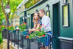 Romantic couple on the balcony decorated with flowers. On Montmartre, Paris Royalty Free Stock Photography
